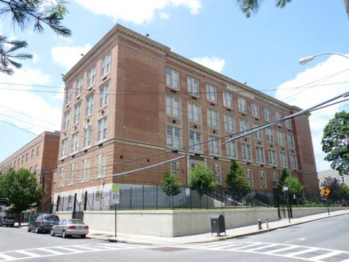 PS 153 Takes Up The East Side Of Block On 60th Lane Between Avenue And Road
