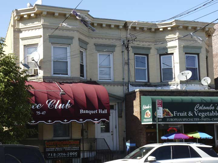 The Painted Ad Abuts A Pair Of Attached Brownstone Or Beigestone Buildings Atypical For Met Ave Could Dance Club Named On Awning Be Same